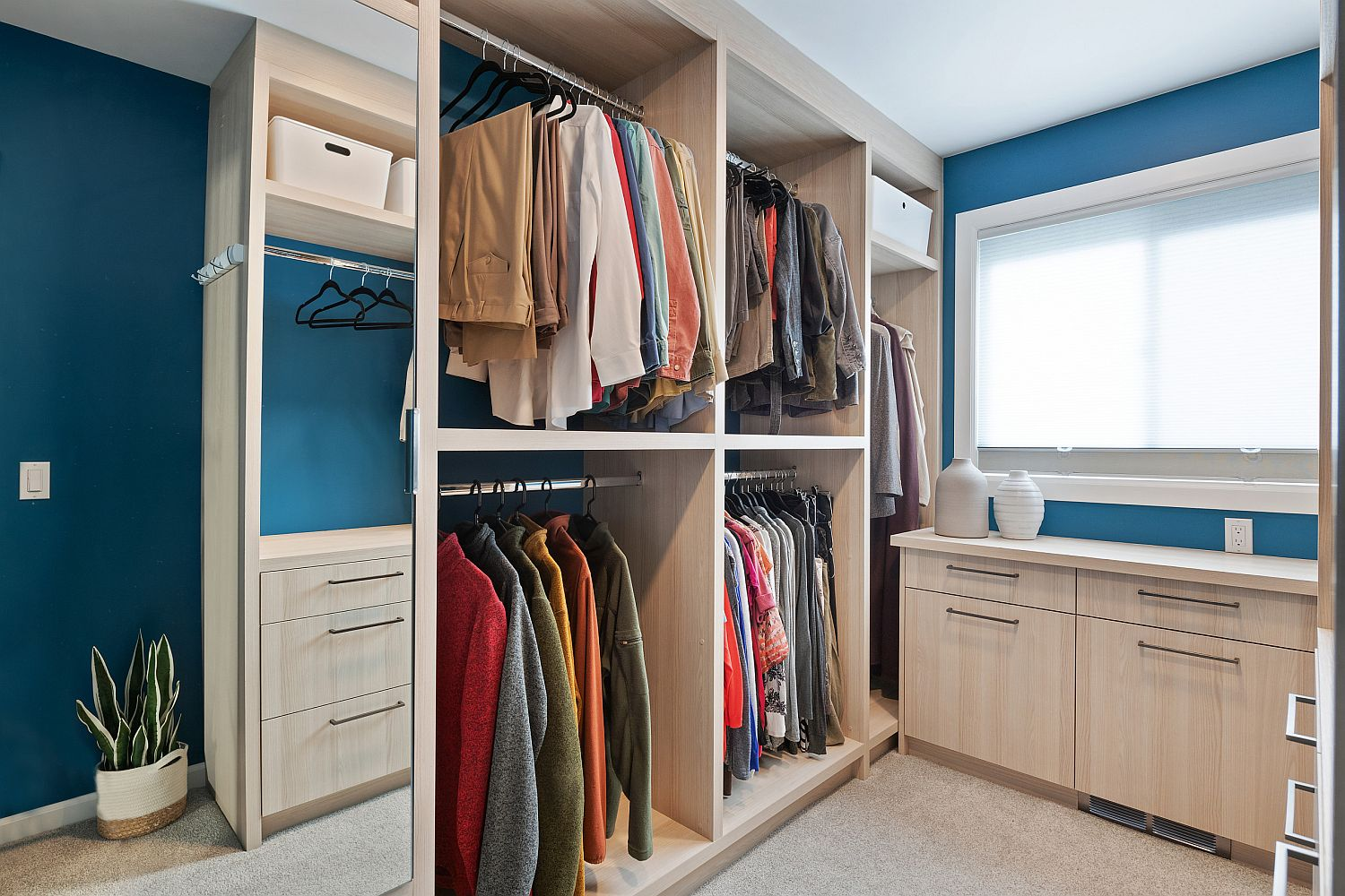 Gender-neutral closet with a simple design in wood