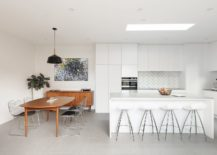 Gorgeous-kitchen-in-white-with-wooden-dining-table-that-stands-out-visually-217x155