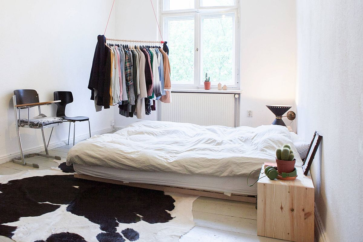Hanging rod adds additional storage space to the bedroom