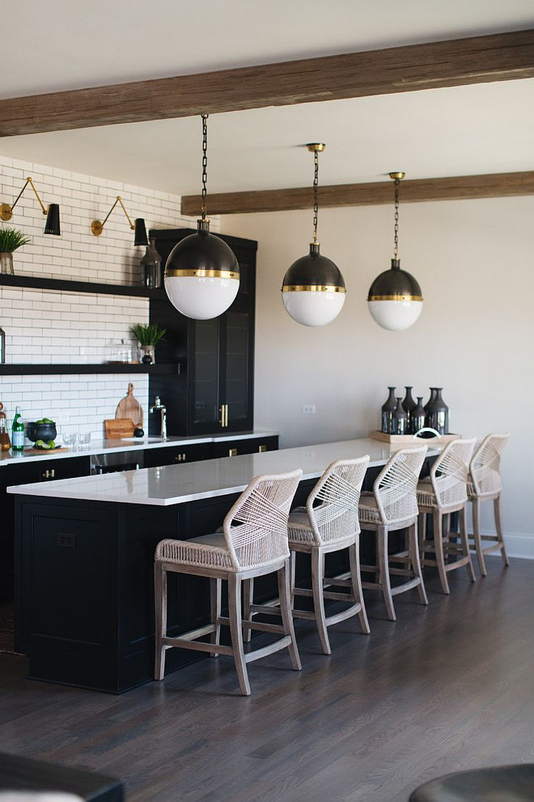 Lighting fixtures, kitchen island and curated cabinets bring black and brass to this kitchen