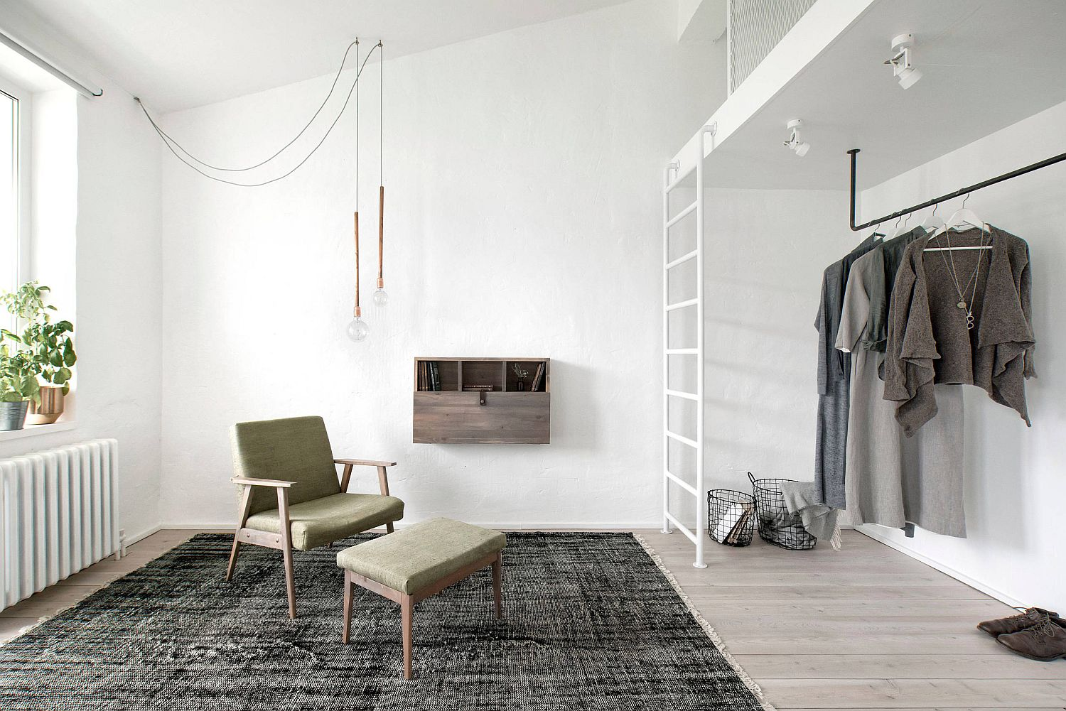 Loft-bed-with-space-underneath-used-as-closet-that-has-simple-rod-to-hang-clothes