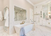 Metallic-accents-along-with-matching-faucets-add-glitter-to-the-white-bathroom-217x155