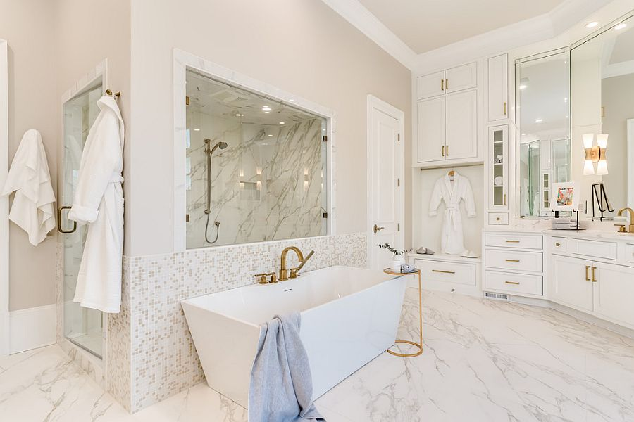 Metallic accents along with matching faucets add glitter to the white bathroom