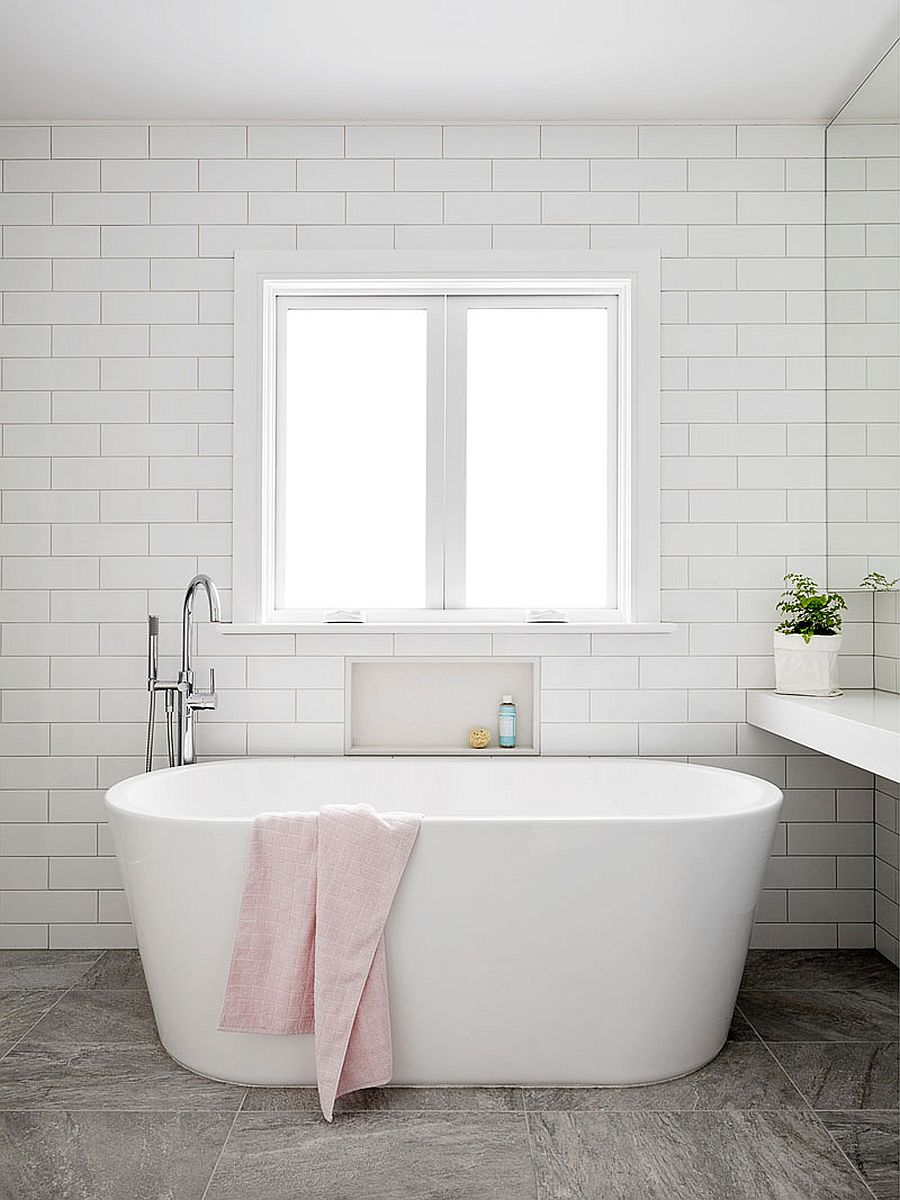 Minimal and modern bathroom of the renovated Aussie home with freestanding bathtub in white