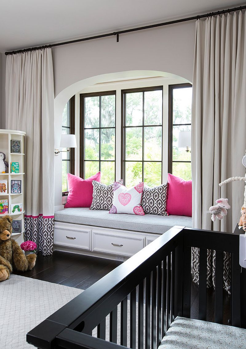 Modern Mediterranean style nursery with a window seat that offers additional storage space