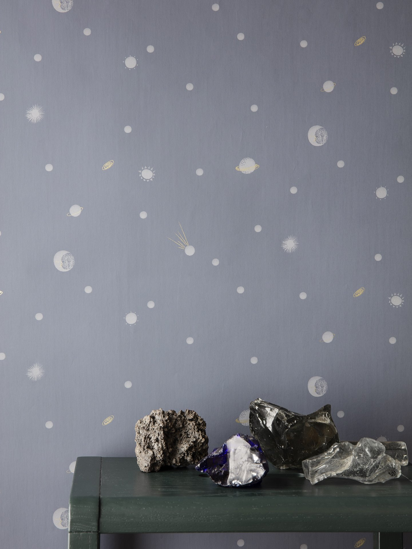 gray wallpaper with celestial pattern