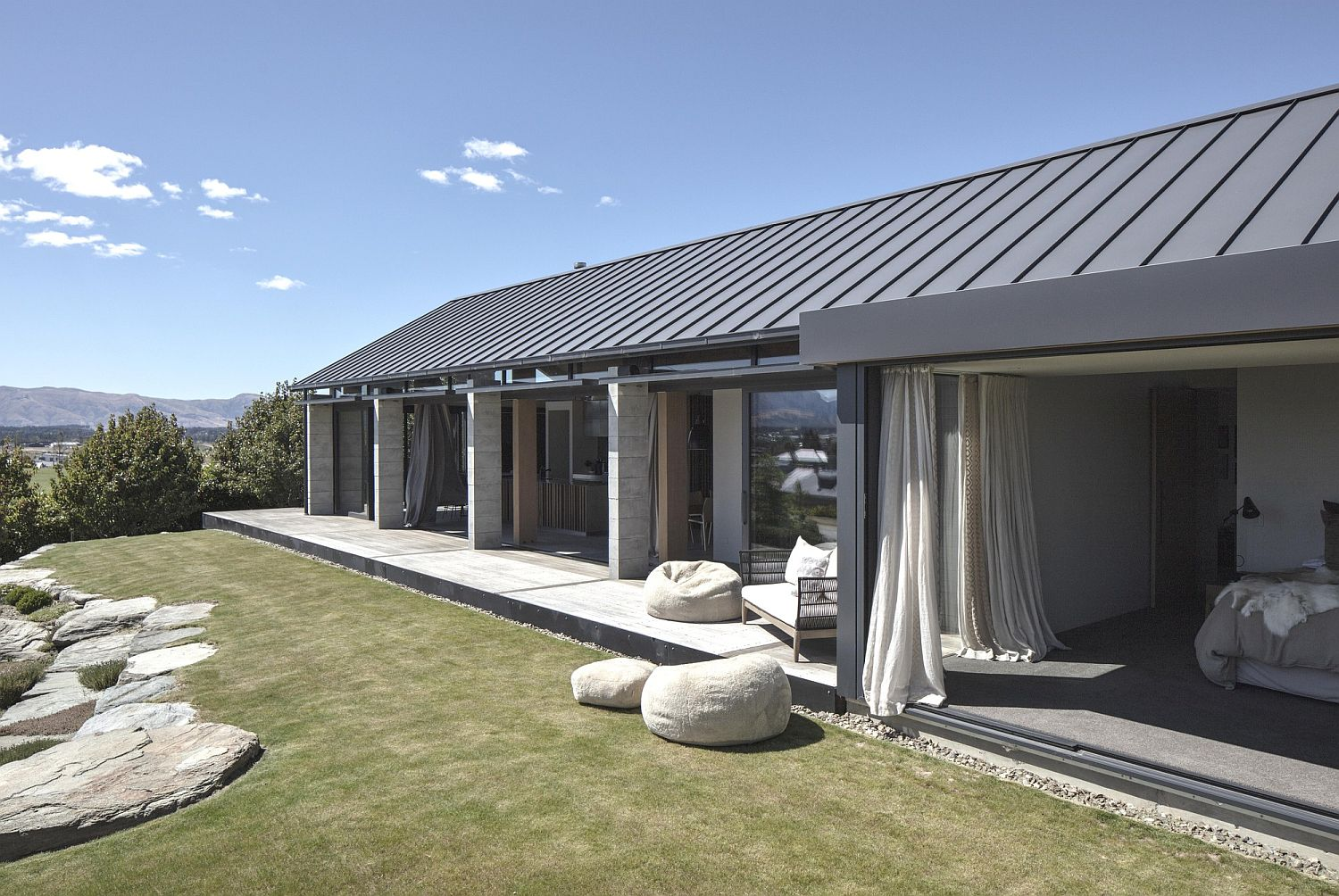 Open design of the house connected to the landscape outside