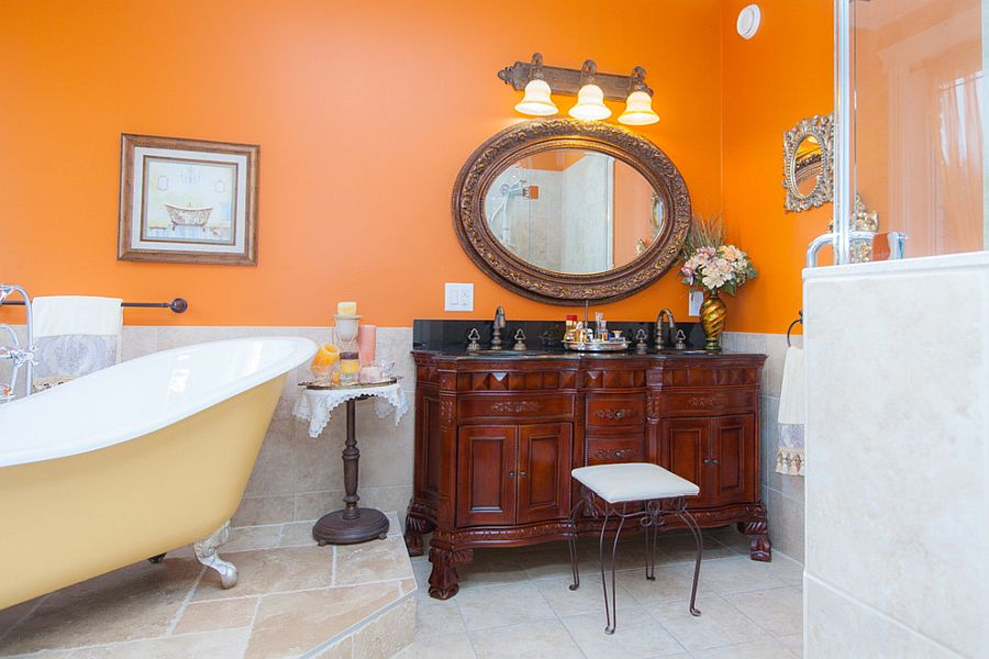 Orange accent wall for the bathroom brings an air of freshness and playfull charm