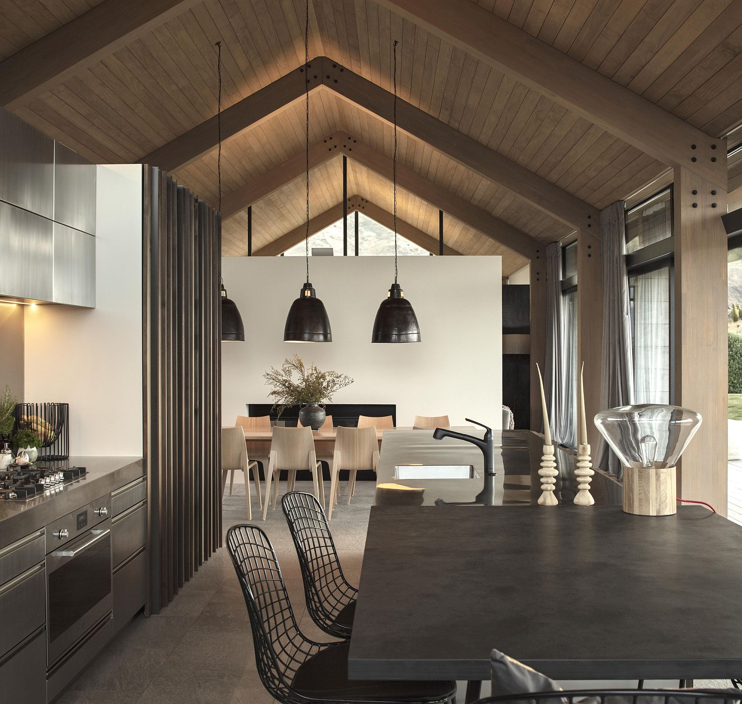 Oversized pendants in black accentuate the gabled roof of the house