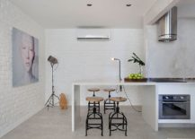 Painting-the-brick-wall-white-inside-the-kitchen-for-a-more-urbane-look-217x155