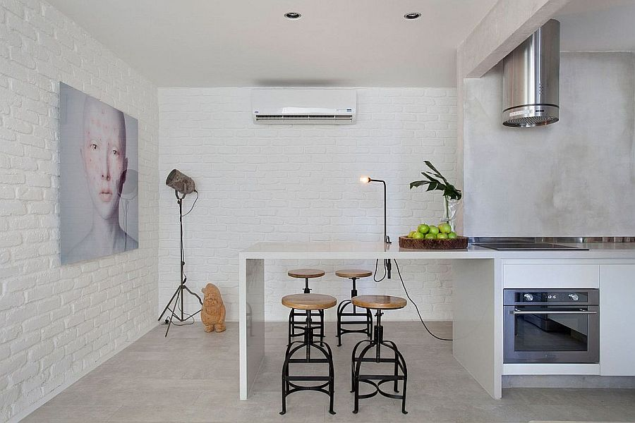 Painting-the-brick-wall-white-inside-the-kitchen-for-a-more-urbane-look