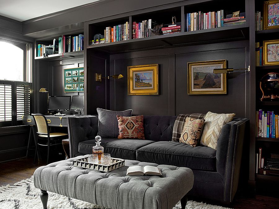 Picture frames on the wall add golden glint to the dark living space