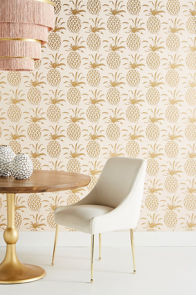 repetitive gold pineapple pattern on cool dining room wallpaper