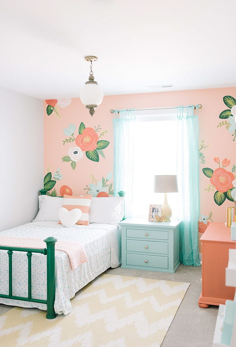 Pink accent wall for the girls' bedroom with floral theme
