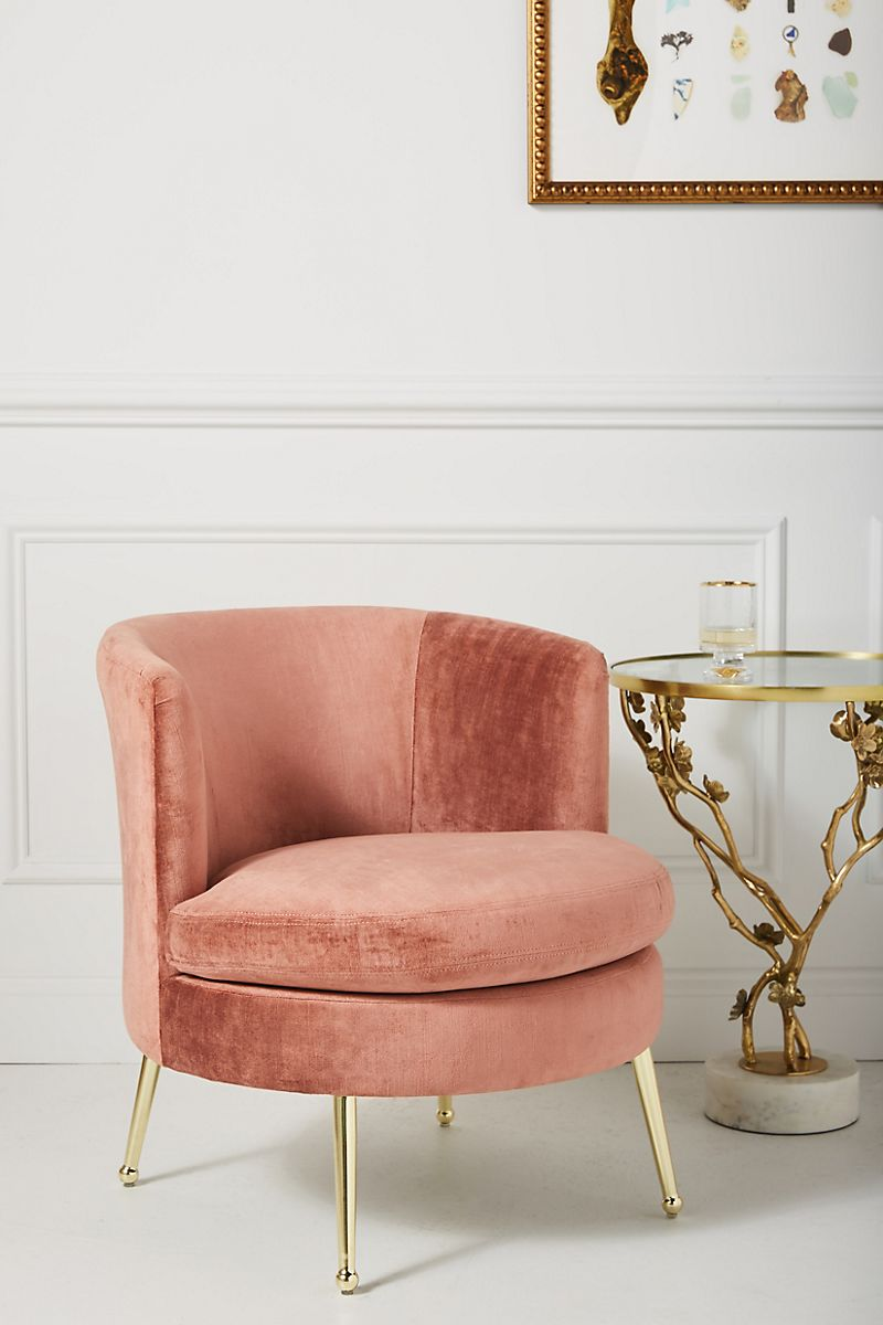 Pink-toned accent chair with brass legs