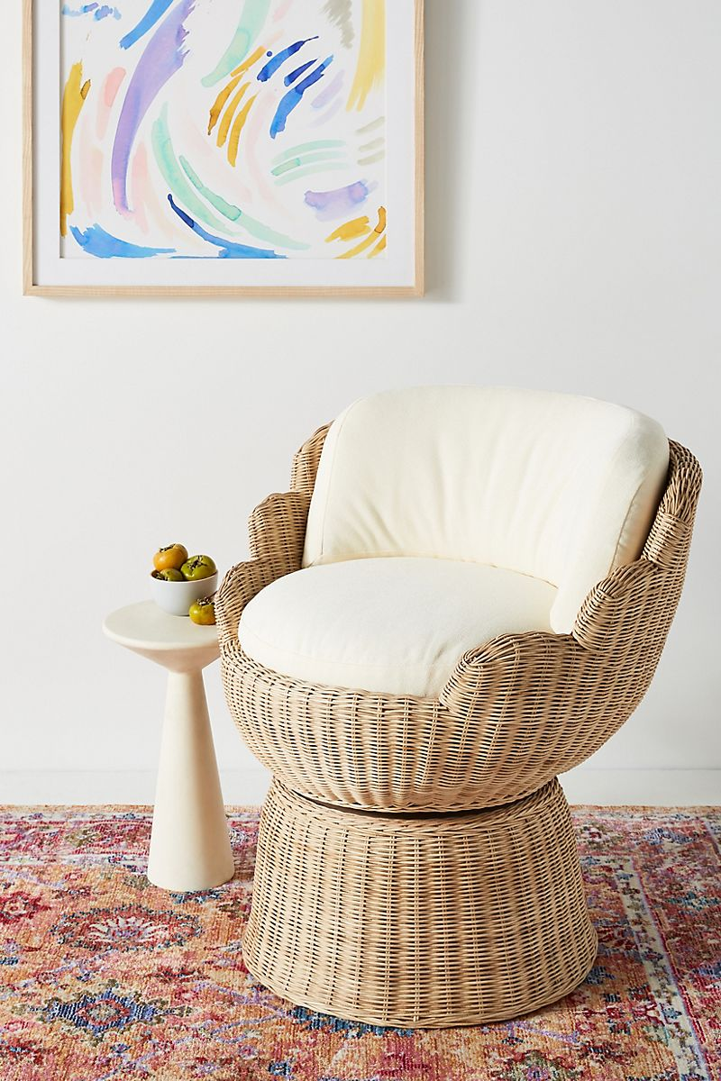 Rattan accent chair designed by Justina Blakeney