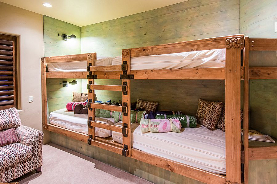Reclaimed wood in pastel green brings a different touch to the kids' bedroom