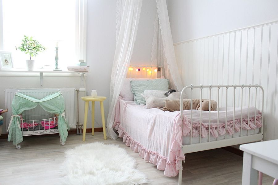Shabby chic kids' bedroom in white with pastel accents all around