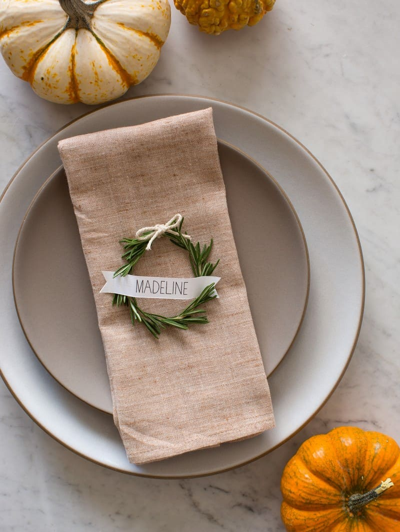 Simple and minimal rosemary place wreaths for the Thanksgiving table