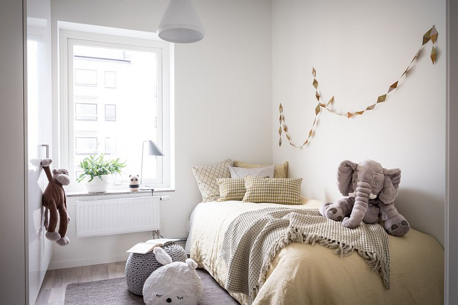 Small kids' room with Scandinavian style in white can be altered easily over time