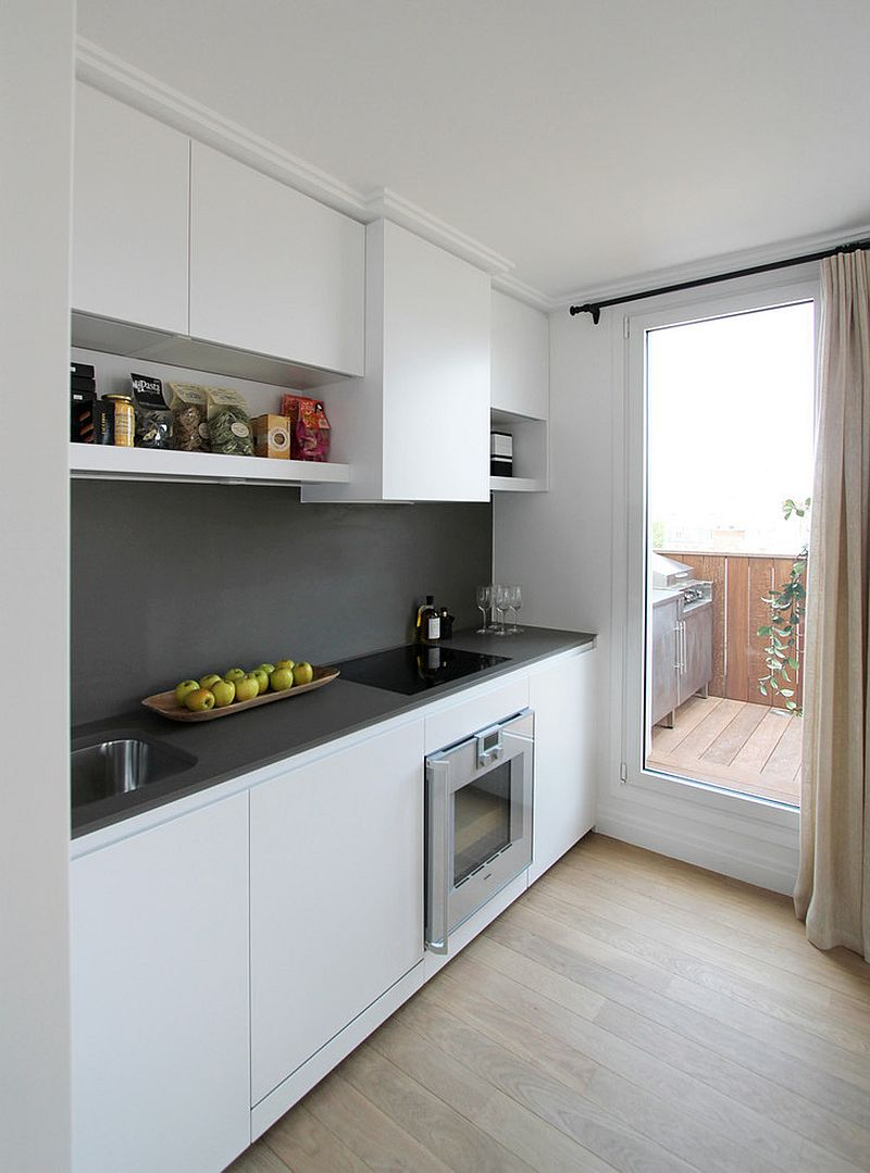 Small-modern-kitchen-of-Paris-apartment-in-white-with-a-gray-backsplash