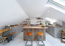 Smart-and-stylish-modern-attic-kitchen-in-gray-and-white-with-a-hint-of-wood-217x155