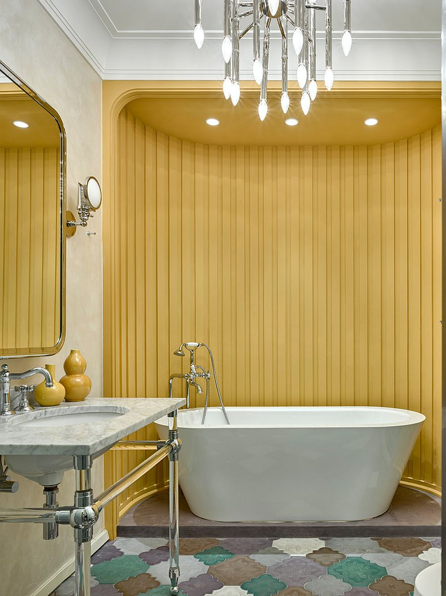 Striped accent wall in yellow for the unique bathroom in white