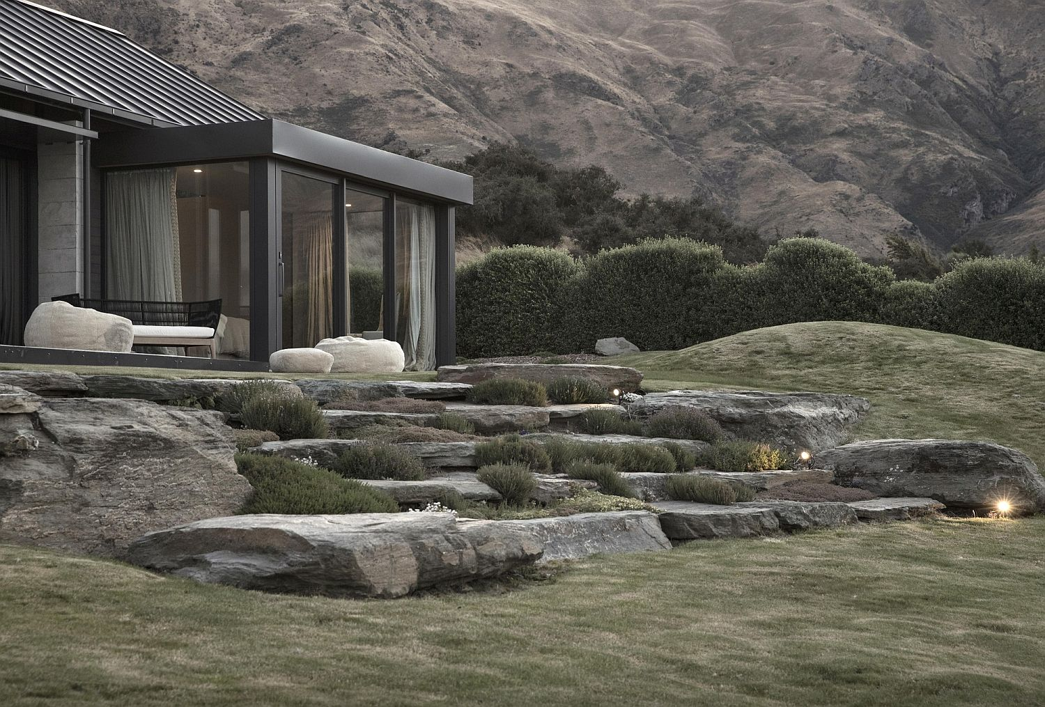 Sustainable house in New Zealand with glass walls and gabled roof