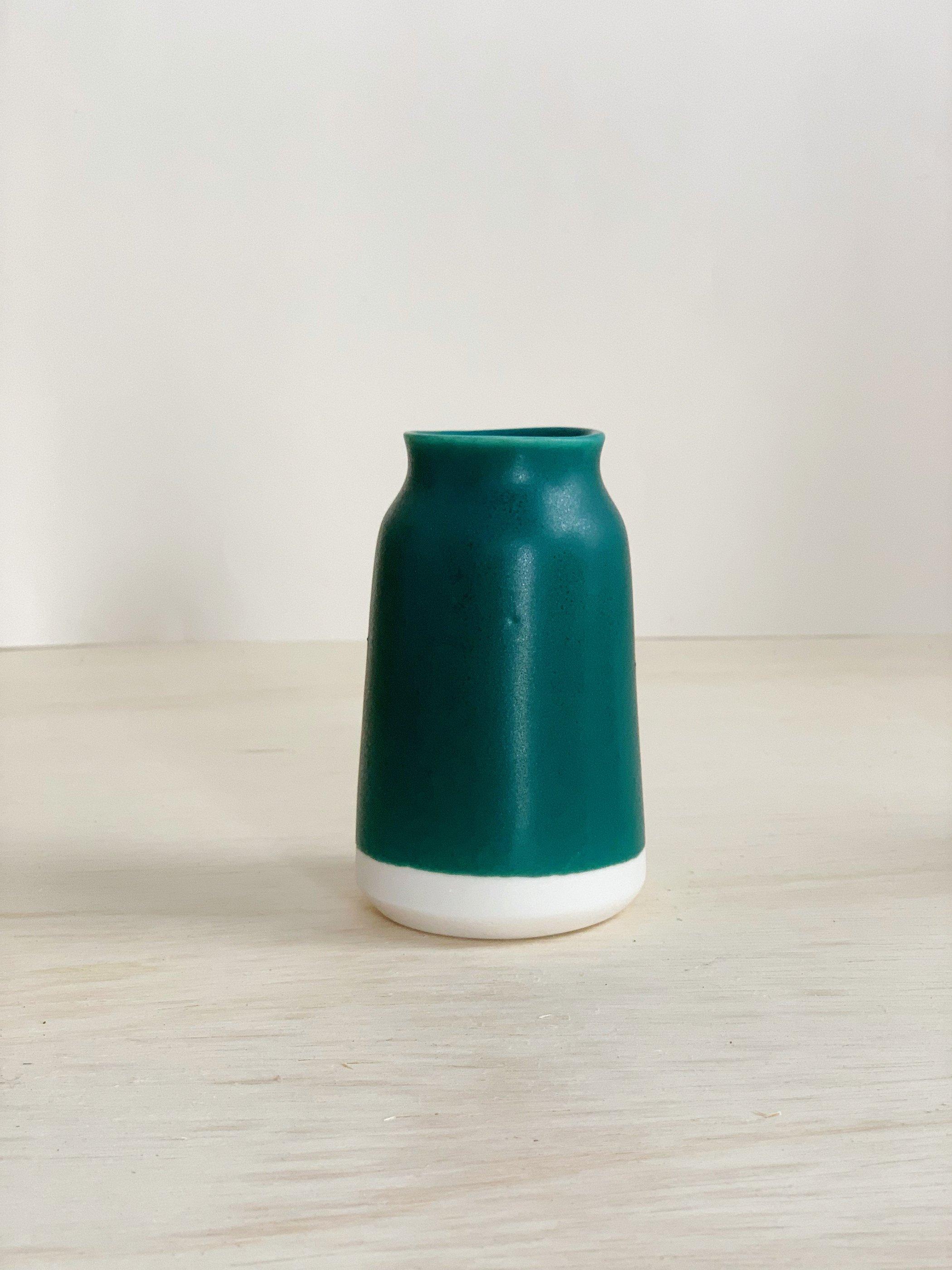 Teal and white milk bottle vase