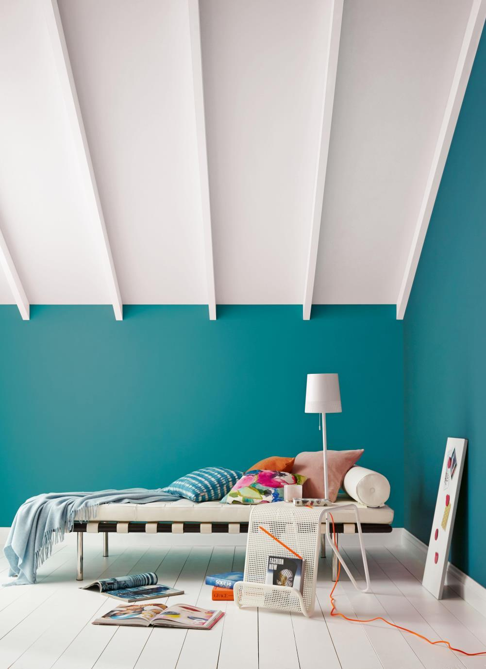 Teal bedroom with pops of color