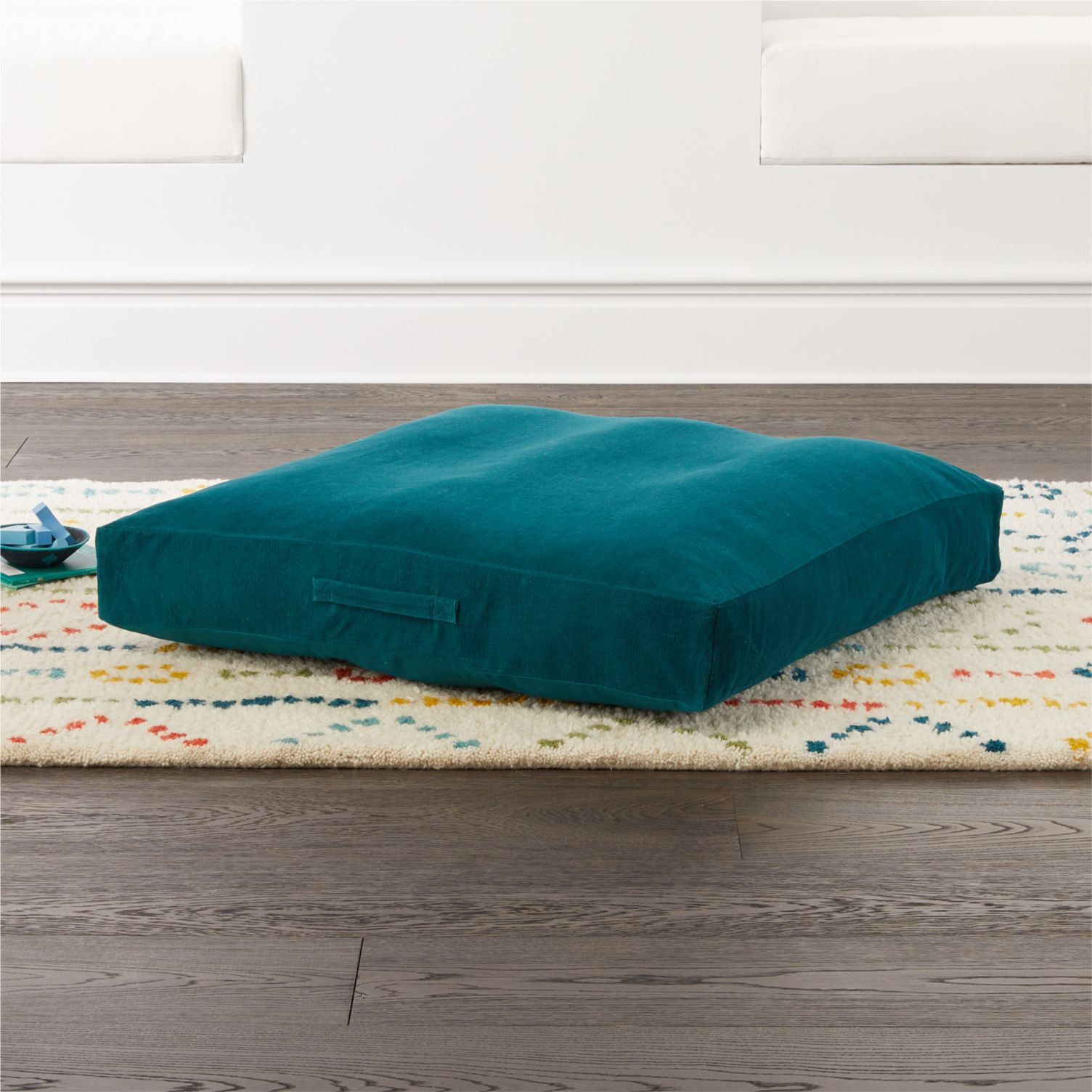 Teal floor cushion from Crate & Kids