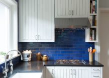 Tiny-kitchen-in-white-with-beautiful-dark-blue-tiled-backsplash-217x155