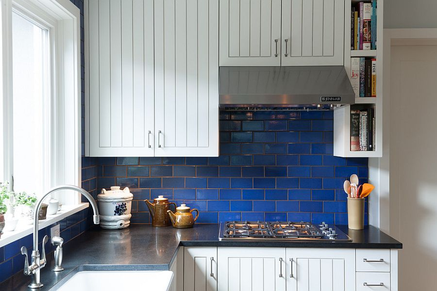 Tiny kitchen in white with beautiful dark blue-tiled backsplash