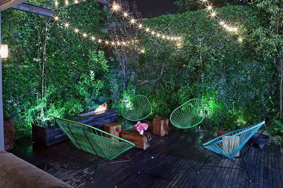 Turn the small and private deck into a romantic getaway with string lighting and colorful chairs