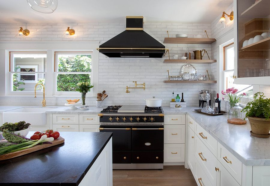 Use kitchen appliances and the island to usher in the black and brass look