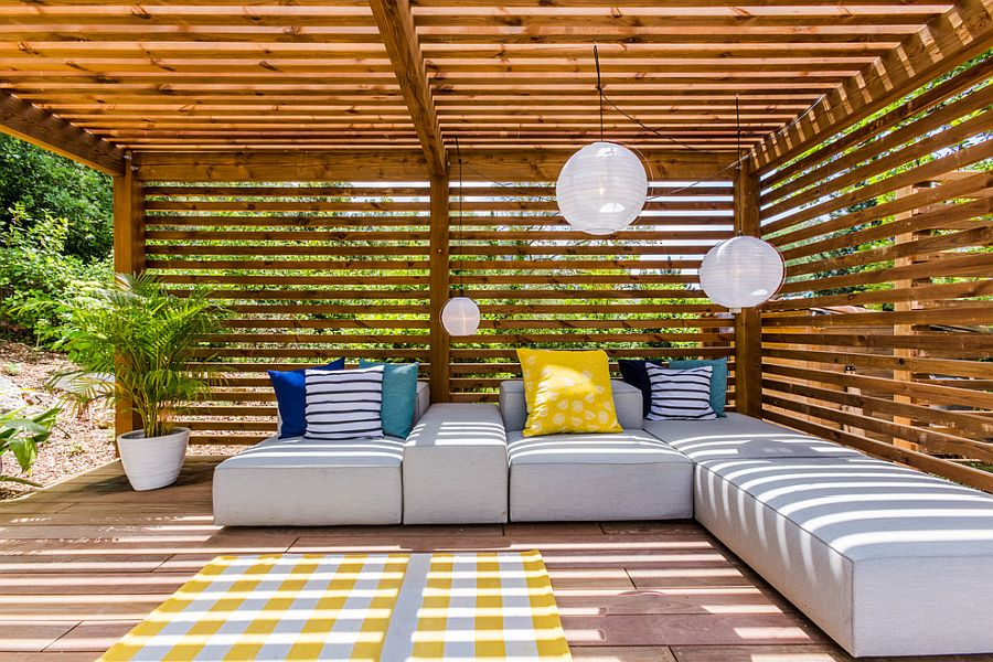 Use throw pillows in multiple colors for a brighter outdoor hangout