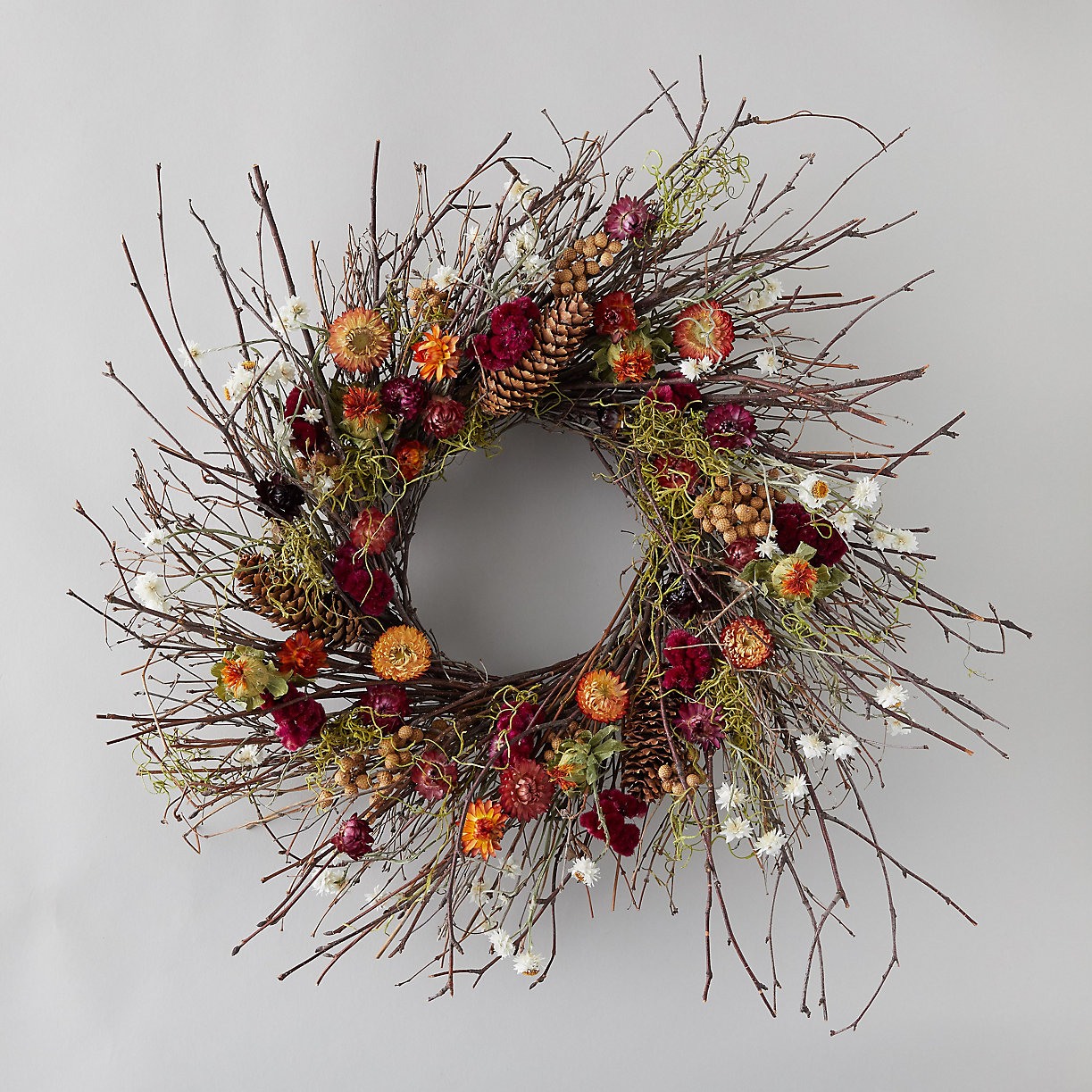 Vibrant fall wreath with birch branches