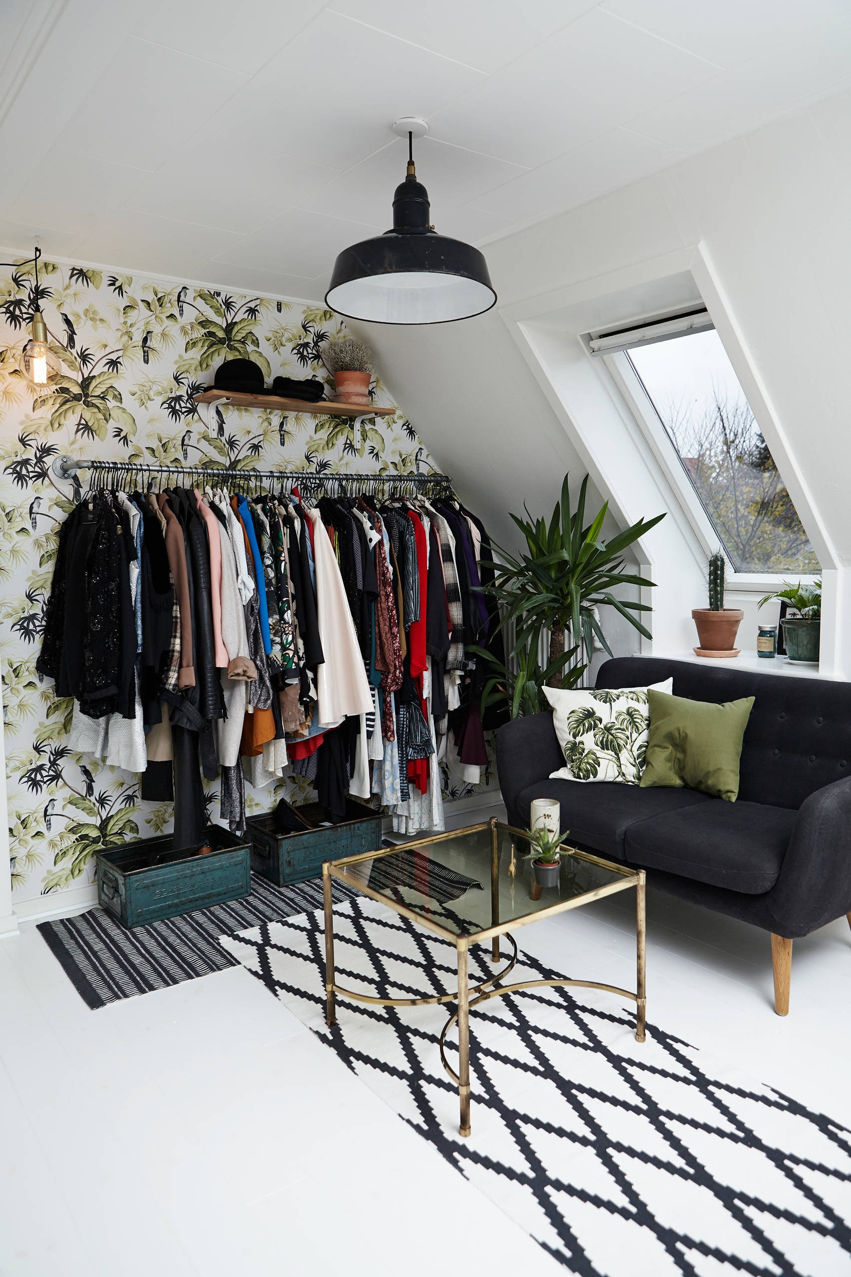 Wallpaper in the backdrop adds color to the standalone closet unit