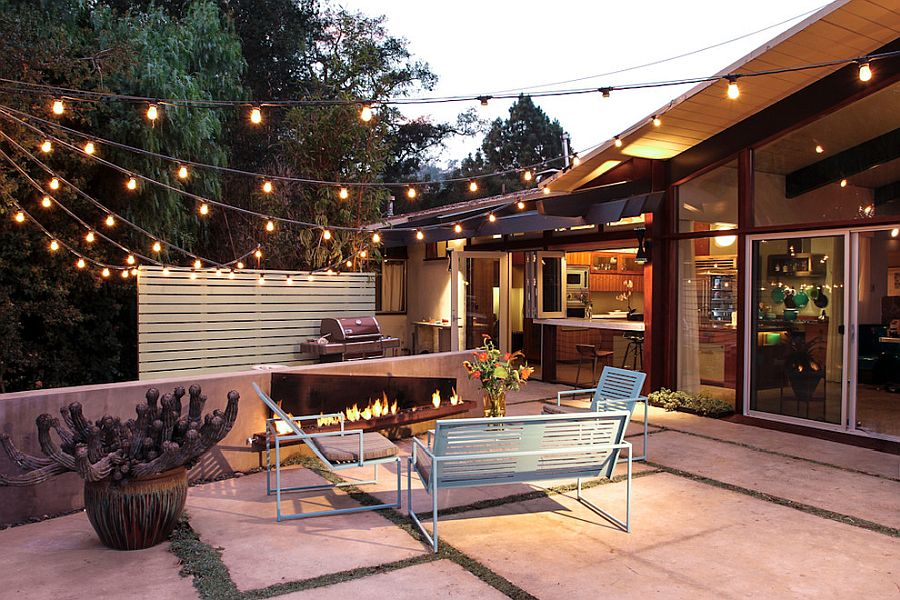 Warm string lighting also gives the outdoor space a festive makeover!