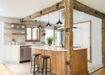Weathered-wooden-beams-bring-a-unique-character-to-the-kitchen-in-white-217x155