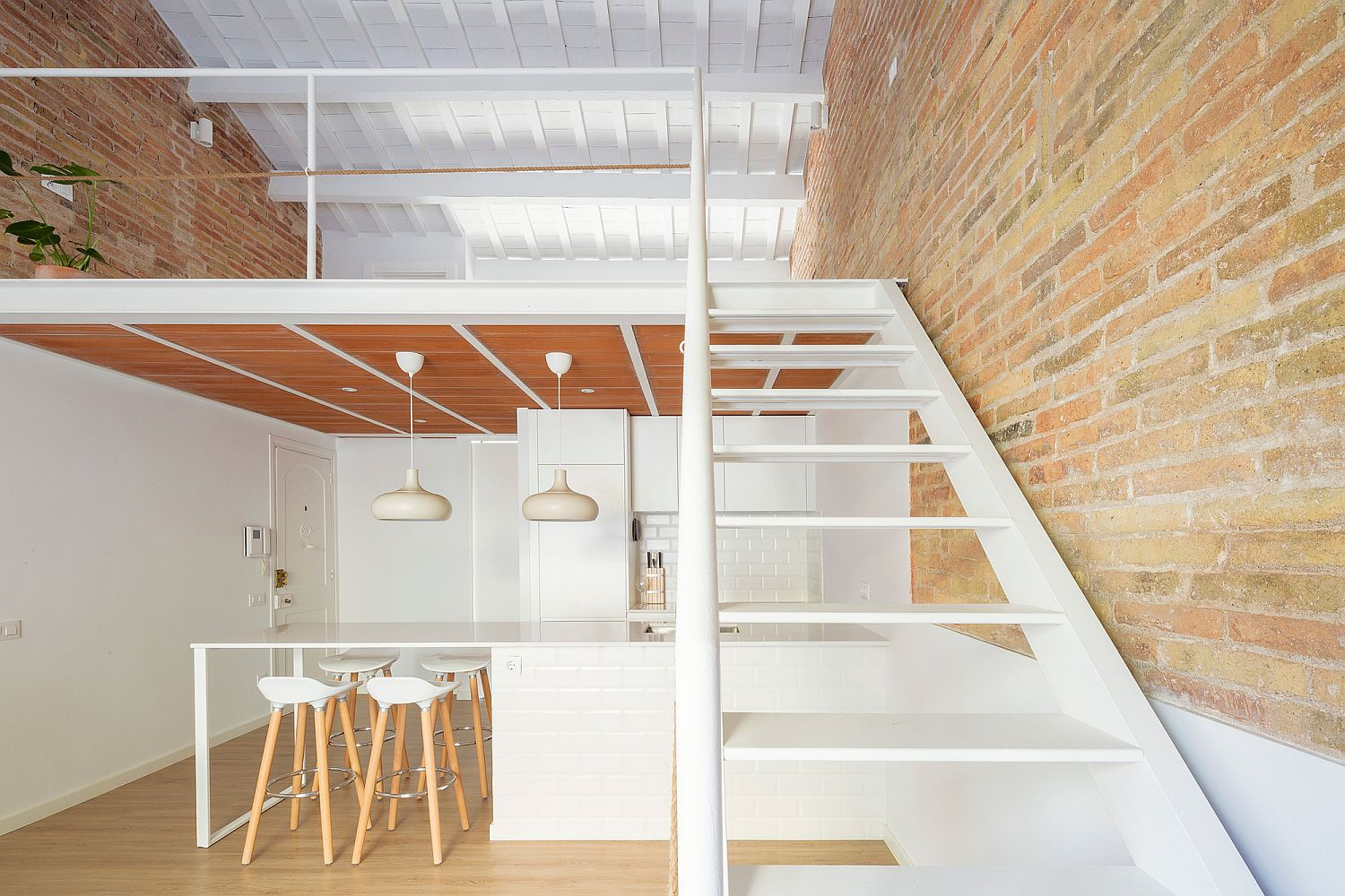 Tiny Barcelona Home Refurbishment in White, Brick and Wood with Mezzanine Level
