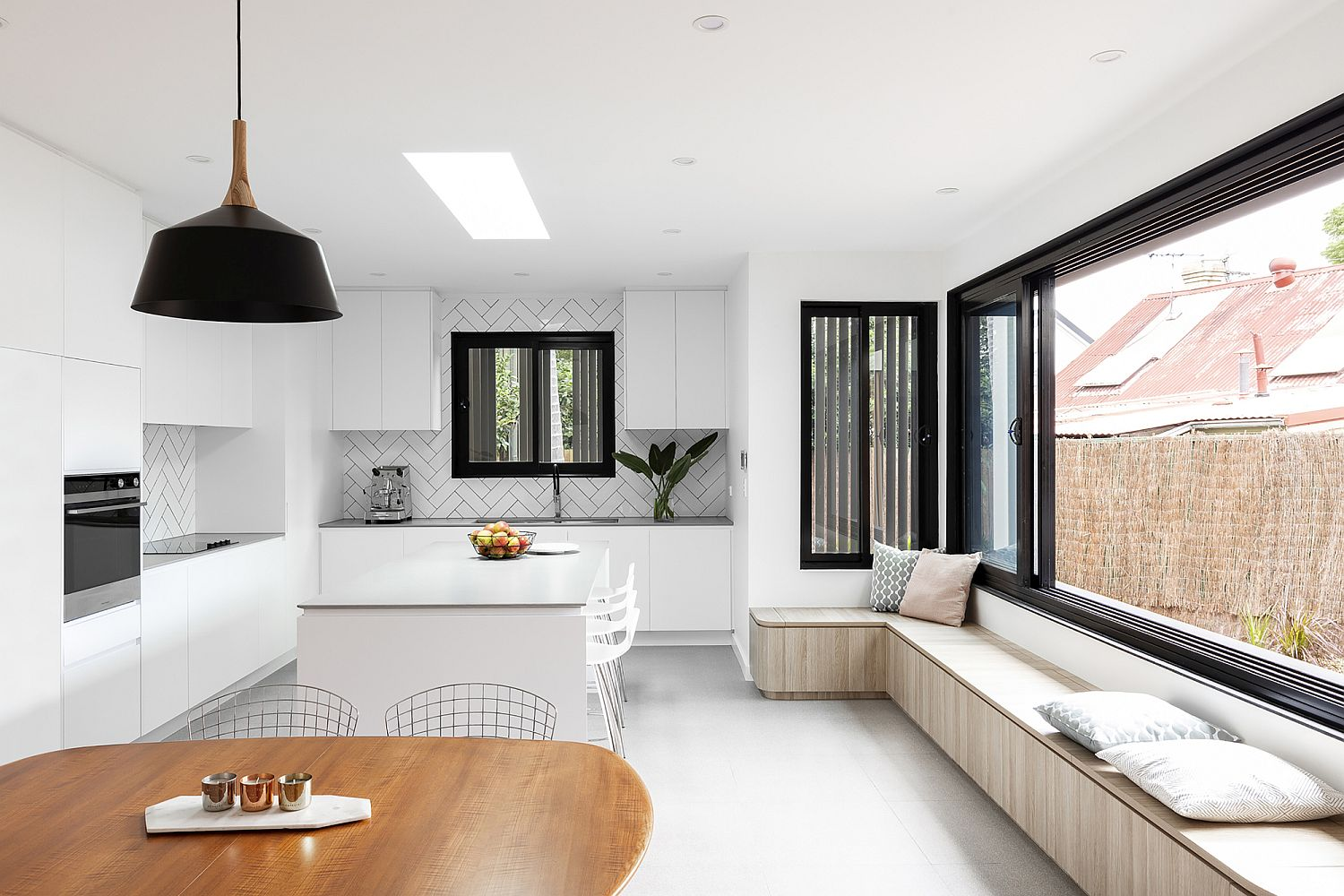 Winow-seat-in-the-kitchen-and-dining-area-with-storage-options-added-to-the-mix