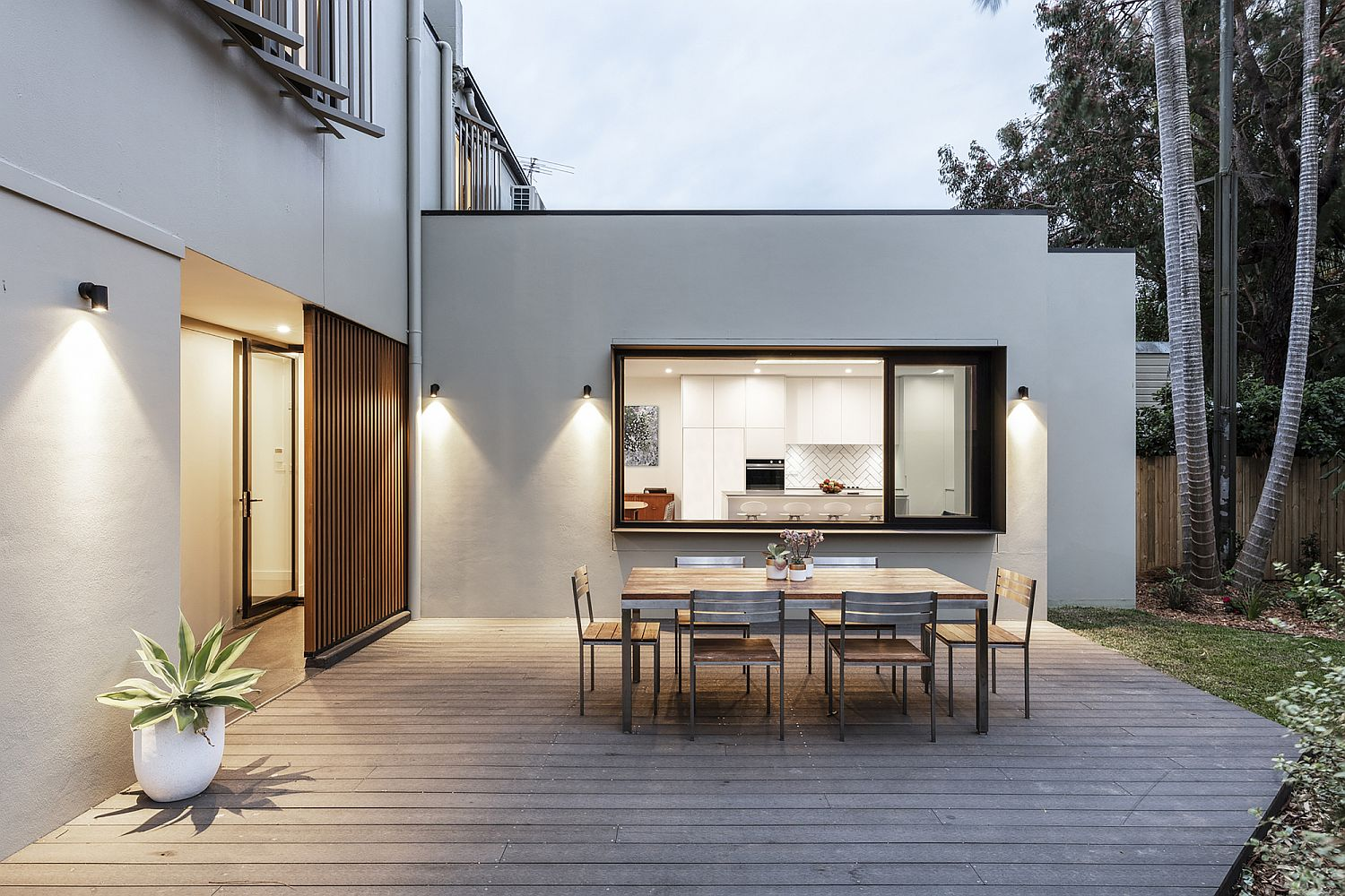 Wooden deck and outdoor dining area of the houe is a showstopper