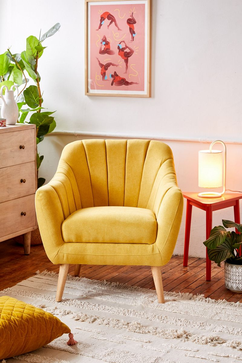 Yellow arm chair with tufted seams