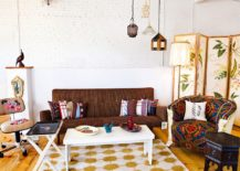 A-hint-of-Moroccan-flair-for-the-eclectic-room-with-whitewashed-brick-backdrop-and-wooden-floor-217x155