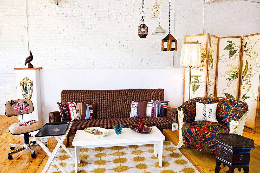 A hint of Moroccan flair for the eclectic room with whitewashed brick backdrop and wooden floor