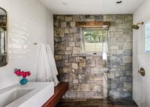 Aceent-stone-wall-for-the-smal-rustic-bathroom-with-tiled-walls-in-white-217x155