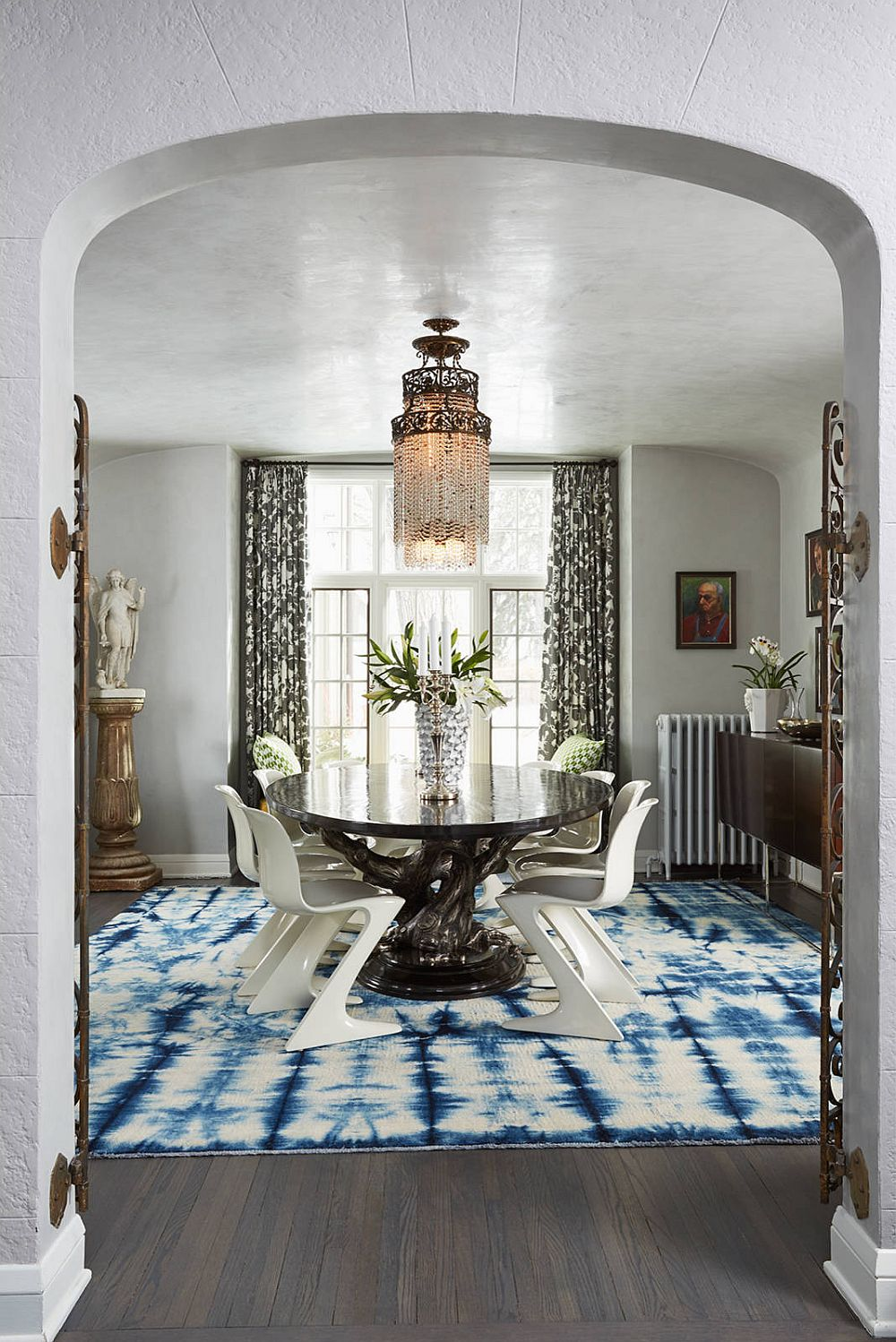 Add color and playfulness to your contemporary dining room in neutral hues with a dashing, colorful rug