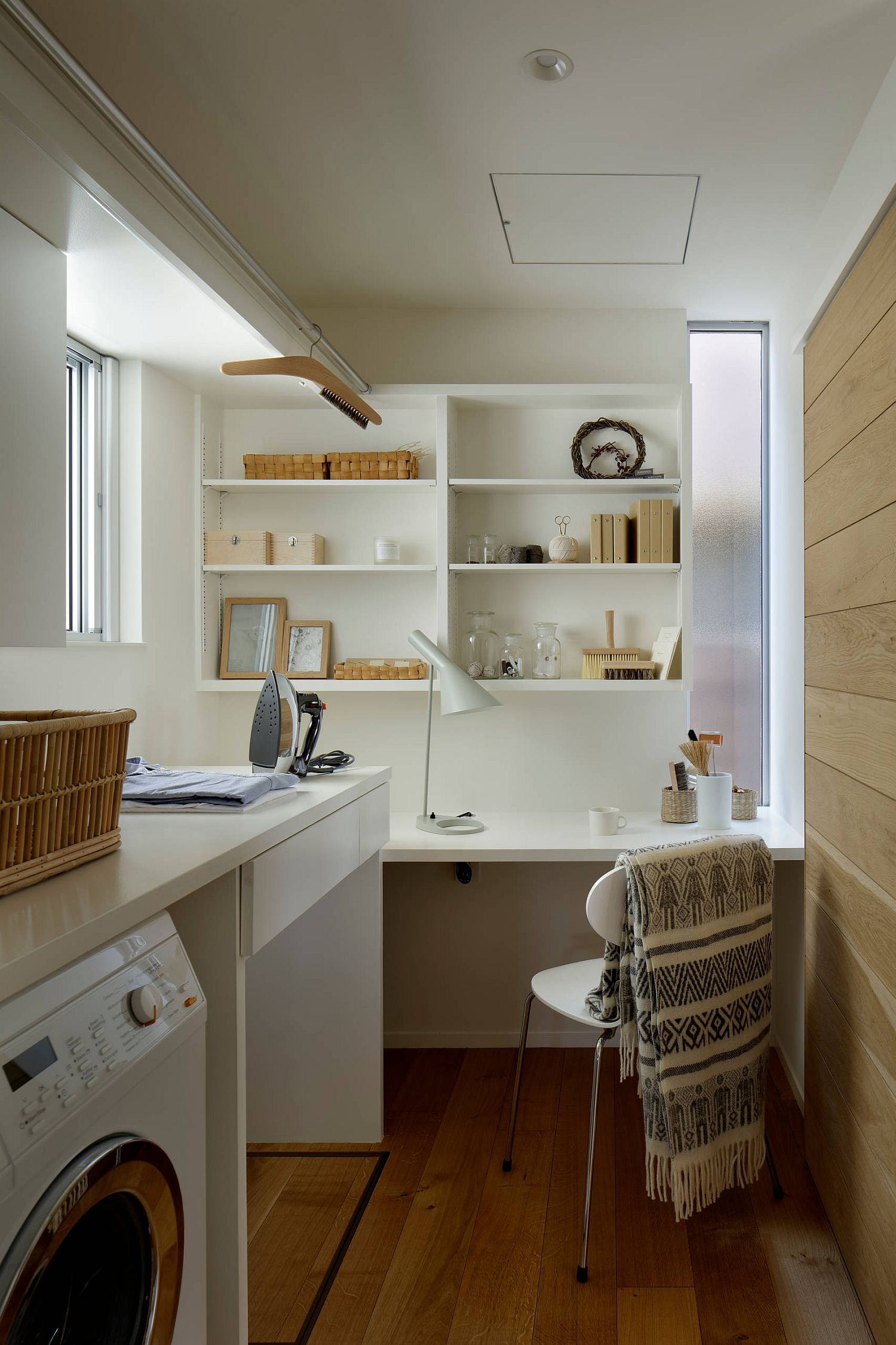 scandinavian style laundry room with home office desk