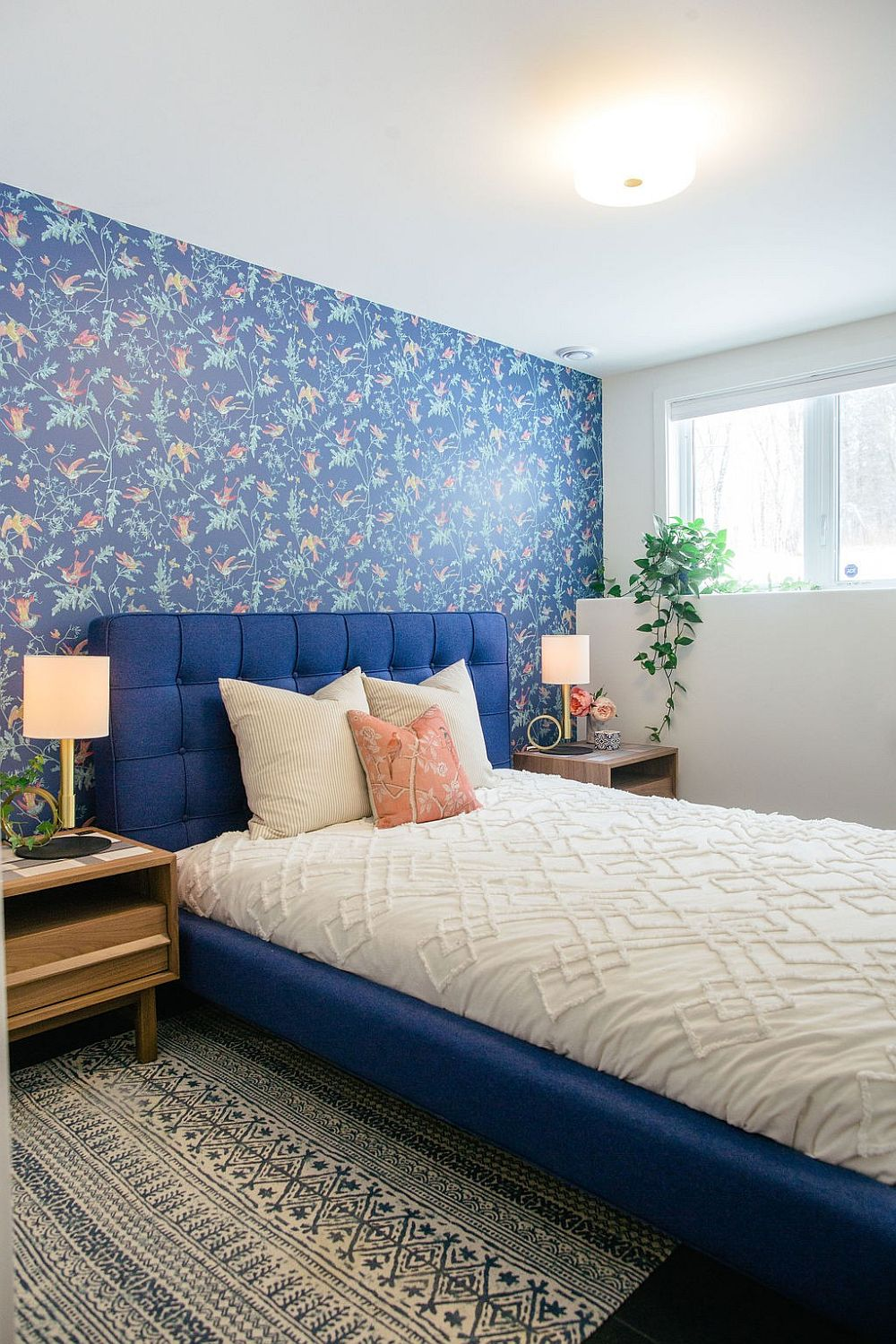 Beautiful blue bedroom with contemporary style and bright lighting